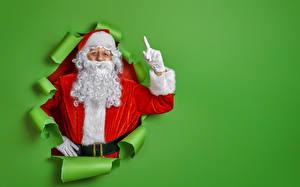 Фотография Рождество Цветной фон Дед Мороз Униформе Бородатые Перчатки Шаблон поздравительной открытки
