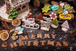 Фото Новый год Печенье Сахарная пудра Доски Слова Английская Дизайн Продукты питания