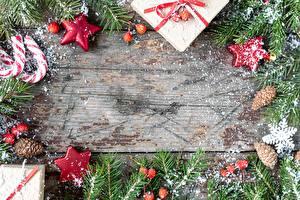 Фото Новый год Леденцы На ветке Звездочки Шишка Снежинки Подарки Коробки