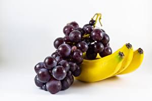 Обои для рабочего стола Вблизи Бананы Виноград Сером фоне Еда