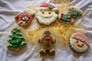 Фотографии Печенье Дизайна Варежки Дед Мороз Новогодняя ёлка Носки Снеговик Продукты питания