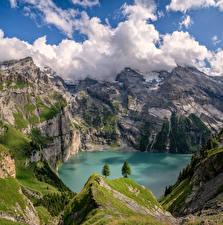 Фотография Швейцария Гора Озеро Альп Утес Облака Berner Oberland Природа