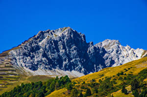 Картинка Швейцария Горы Небо Утес Graubünden Природа