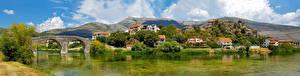 Обои Босния и Герцеговина Река Мост Горы Дома Trebinje, panorama город