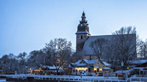 Картинка Финляндия Зима Рождество Дома Причалы Вечер Naantali город
