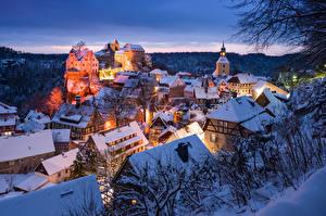 Картинки Германия Зимние Вечер Здания Замок Церковь Снегу Hohnstein Города