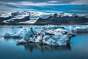 Фотографии Исландия Озеро Горы Лед Jökulsárlón Природа