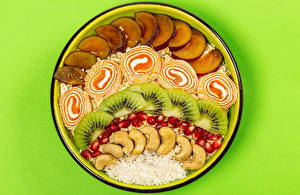 Обои для рабочего стола Овсянка Яблоки Киви Мармелад Гранат Орехи Цветной фон Тарелка Зерна Еда