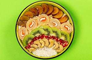 Картинка Овсянка Яблоки Киви Мармелад Гранат Орехи Цветной фон Тарелка Зерна Еда