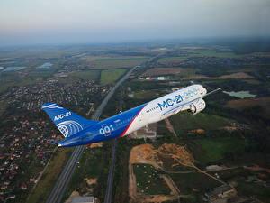 Картинки Самолеты Пассажирские Самолеты Российские Летящий MC-21-300