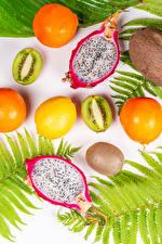 Фотография Драконий фрукт Фрукты Киви Апельсин Лимоны Пища