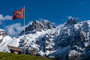 Обои Швейцария Горы Флаг Скамейка Траве Снегу Альпы Природа