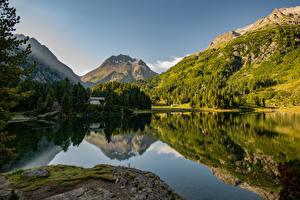 Картинки Швейцария Гора Озеро Альп Отражение Lake Cavloc Природа