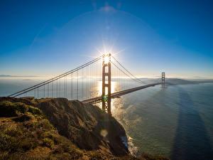 Обои США Мосты Калифорния Сан-Франциско Солнце Golden Gate Bridge Природа картинки