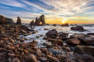 Картинка Ирландия Берег Камень Рассвет и закат Небо Скала Donegal