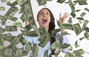 Обои для рабочего стола Деньги Купюры Доллары Много Брюнетки Кричит молодая женщина