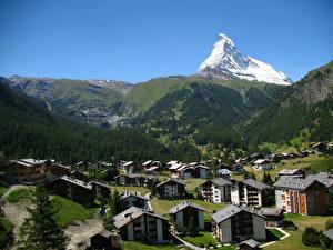 Фотография Горы Швейцария Дома Леса Деревня Zermatt, canton Valais Города