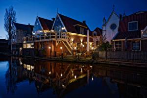 Фотография Нидерланды Здания Ночью Водный канал Уличные фонари Забор De Rijp город
