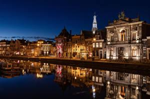 Картинка Голландия Здания Реки Набережная Отражение Haarlem Города