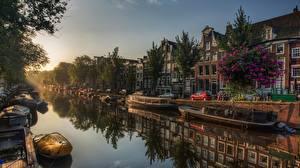 Фотография Рассветы и закаты Амстердам Нидерланды Лодки Водный канал Деревья город