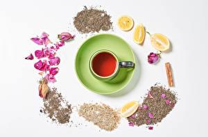 Картинка Чай Лимоны Корица Белый фон Чашке Лепестки Еда