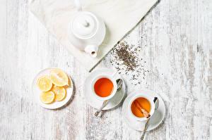 Фото Чай Лимоны Доски Вдвоем Чашка Еда
