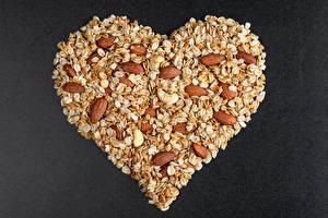 Фотографии День святого Валентина Овсянка Орехи Серый фон Сердце Продукты питания