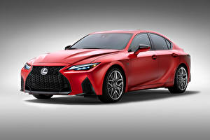 Фото Лексус Красный Металлик Серый фон IS 500 F SPORT Performance, North America, 2021 Автомобили