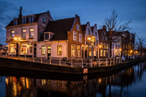 Картинки Голландия Дома Вечер Водный канал Набережная Haarlem Города