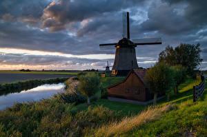 Картинки Голландия Дома Реки Вечер Ветряная мельница Деревья Schermerhorn Природа