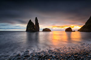Фотографии Португалия Рассвет и закат Побережье Камни Залив Утес Alagoa Природа
