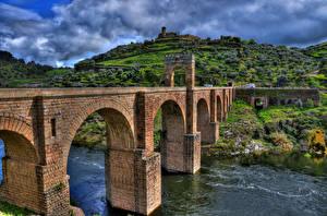 Картинка Речка Мосты Испания Холмы HDR Alcantara Bridge, Tagus river, province Caceres