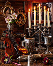 Фотографии Натюрморт Ветреница Свечи Скрипки Книги Цветы