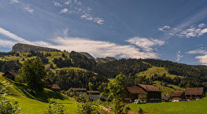 Картинка Швейцария Дома Лес Деревня Холмы Wildhaus-Alt St. Johann, Saint Gall Города Природа