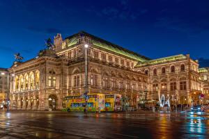 Картинки Австрия Вена Дома Вечер Скульптуры Городская площадь Уличные фонари Vienna State Opera