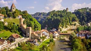 Картинка Мосты Реки Здания Швейцария Холмов Fribourg