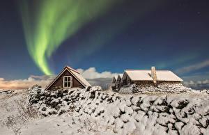 Обои для рабочего стола Исландия Дома Зимние Звезды Небо Снега Полярное сияние Reykjavik Природа