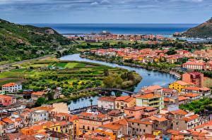 Картинка Италия Реки Здания Мост Море Bosa, Temo river город
