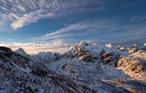Обои Норвегия Лофотенские острова Гора Небо Снега Облака Sommarset Природа
