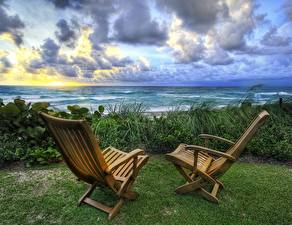 Картинка Рассвет и закат Море Горизонт Траве Кресло Вдвоем Природа