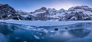 Фото Швейцария Горы Озеро Альпы Льда Oeschinensee Природа