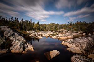 Картинка Канада Камни Квебек Деревьев Облачно Природа