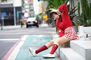 Фотографии Азиатка Боке Сидит Ноги Юбки Руки Косы Взгляд Поза Девушки