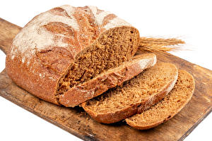 Фото Хлеб Разделочной доске Нарезанные продукты Продукты питания