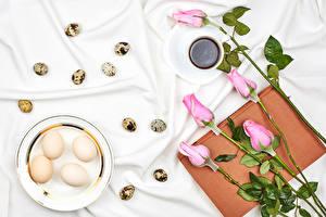 Фотографии Пасха Роза Кофе Тарелке Яйца Розовых Чашке Книга Пища Цветы
