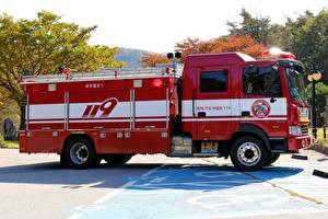 Фото Пожарный автомобиль Сбоку Красные Автомобили