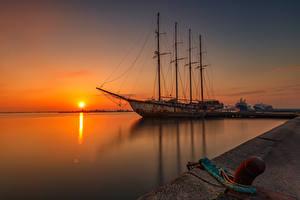 Обои для рабочего стола Пристань Корабль Рассветы и закаты Солнца Природа
