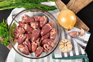Фотография Мясные продукты Лук репчатый Чеснок chicken hearts Продукты питания