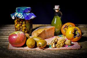 Фотография Хурма Хлеб Яблоки Киви Грецкий орех Доски Банки Бутылка Еда