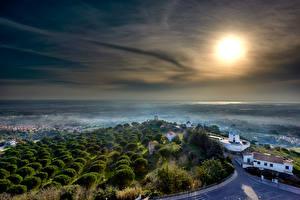 Обои для рабочего стола Португалия Замок Здания Тумане Солнце Castelo de Palmela Города
